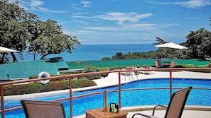 2 outdoor pools, open 11:00 AM to 7:00 PM, pool umbrellas