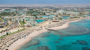 Private beach, free beach shuttle, sun loungers, beach umbrellas