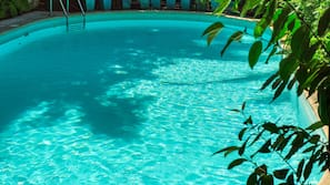 Seasonal outdoor pool, open 8:00 AM to 7:00 PM, pool loungers