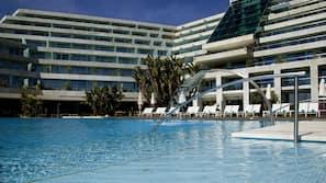 Indoor pool, outdoor pool, open 7 AM to 8 PM, pool umbrellas