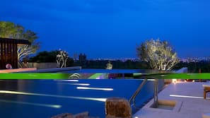 Outdoor pool, open 8:00 AM to 10:00 PM, pool loungers