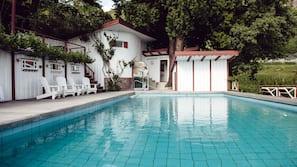 Seasonal outdoor pool, open 7:30 AM to 8:00 PM, pool umbrellas
