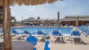 2 outdoor pools, open 7:00 AM to 9:00 PM, pool umbrellas