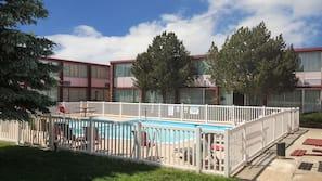 Seasonal outdoor pool, open 8:00 AM to 11:00 PM, sun loungers