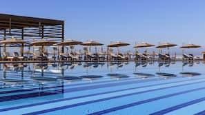 Indoor pool, 3 outdoor pools, pool cabanas (surcharge), pool umbrellas