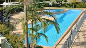 2 outdoor pools, open 8:00 AM to 9:00 PM, pool loungers