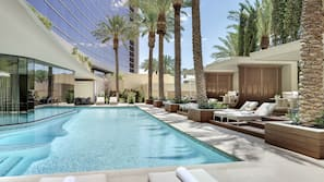 9 outdoor pools, open 9 AM to 6 PM, cabanas (surcharge), pool umbrellas