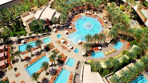 2 outdoor pools, open 9 AM to 6 PM, cabanas (surcharge), pool umbrellas