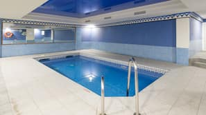 Indoor pool, outdoor pool, open 10 AM to 7 PM, pool umbrellas