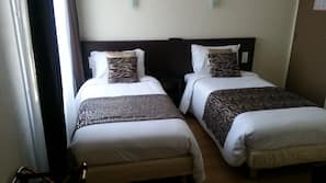 Premium bedding, desk, iron/ironing board, free cots/infant beds