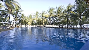 Outdoor pool, open 7 AM to 7 PM, pool umbrellas, pool loungers