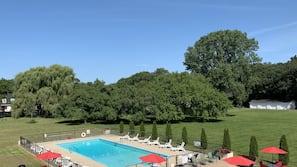 Seasonal outdoor pool, open 10:00 AM to 7:30 PM, pool umbrellas