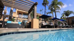 Outdoor pool, open 9:00 AM to 9:00 PM, free pool cabanas, pool umbrellas