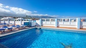 Seasonal outdoor pool, open 10 AM to 6 PM, pool umbrellas