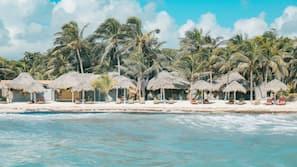 On the beach, white sand, beach umbrellas, beach towels