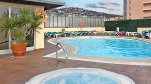 Outdoor pool, a rooftop pool, sun loungers
