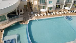 2 outdoor pools, open 8:00 AM to 10:00 PM, pool umbrellas