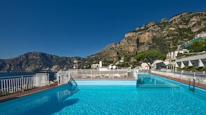 Outdoor pool, open 9:00 AM to 8:00 PM, pool umbrellas, sun loungers