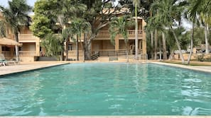 Outdoor pool, a rooftop pool, open 7 AM to 9 PM, sun loungers