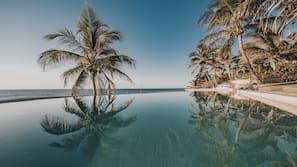 Private beach, white sand, free beach cabanas, beach umbrellas