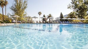 Outdoor pool, open 10:00 AM to 7:00 PM, pool umbrellas, sun loungers