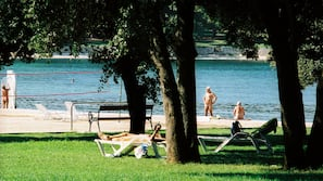 On the beach, sun loungers, beach umbrellas, rowing