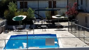 Seasonal outdoor pool, open 8:00 AM to 10:30 PM, pool umbrellas