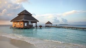 Private beach, white sand, beach towels, scuba diving