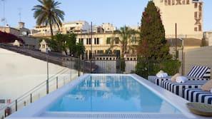 Seasonal outdoor pool, open 11 AM to 8 PM, sun loungers