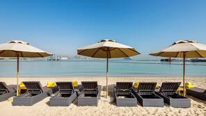 On the beach, white sand, sun-loungers, beach bar