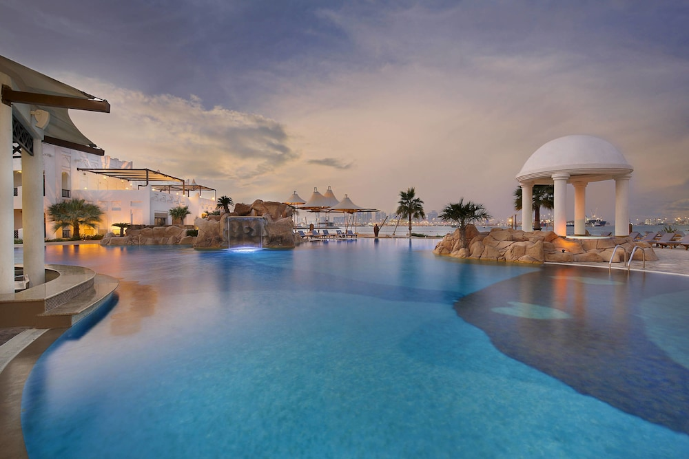 Outdoor Pool, Sharq Village & Spa, a Ritz-Carlton Hotel