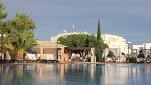 Indoor pool, seasonal outdoor pool, open 9 AM to 7:30 PM, pool loungers
