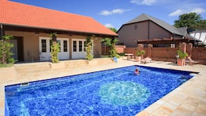 Outdoor pool, open 8 AM to 9 PM, pool loungers