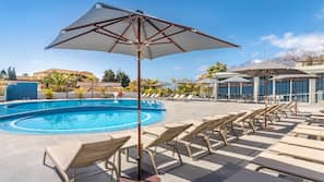 Outdoor pool, open 10 AM to 7 PM, pool umbrellas, pool loungers