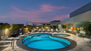 Outdoor pool, open 7:00 AM to 11:00 PM, pool umbrellas, pool loungers