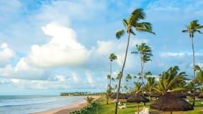 On the beach, white sand, beach towels, beach massages