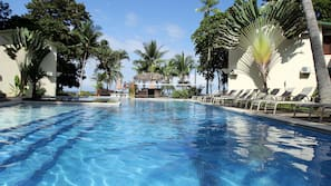 Outdoor pool, open 7:00 AM to 10:00 PM, pool umbrellas, pool loungers