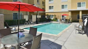 Outdoor pool, open 10:00 AM to 9:00 PM, sun loungers
