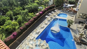 2 outdoor pools, open 8:30 AM to 6:00 PM, pool umbrellas, pool loungers