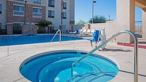 Outdoor pool, open 7:00 AM to 11 PM, pool umbrellas