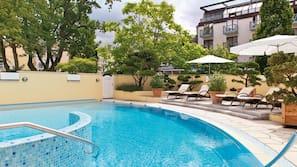 Indoor pool, outdoor pool, open 7:00 AM to 10:00 PM, pool umbrellas