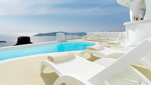Outdoor pool, pool umbrellas, pool loungers