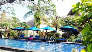 Outdoor pool, open 7 AM to 6:00 PM, pool umbrellas