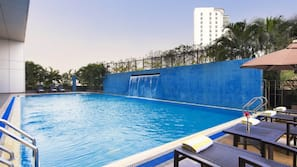 Outdoor pool, open 7:00 AM to 11 PM, pool umbrellas, sun loungers