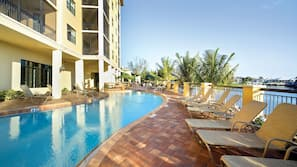 Outdoor pool, open 9 AM to 7 PM, sun loungers