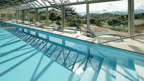 Indoor pool, open 7 AM to 9 PM, pool umbrellas, sun loungers