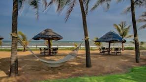 On the beach, beach umbrellas, beach towels, beach volleyball