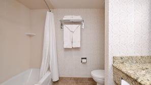 Combined shower/tub, designer toiletries, hair dryer, towels