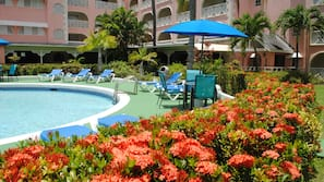 2 outdoor pools, open 7 AM to 9 PM, pool umbrellas, pool loungers