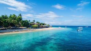Private beach, white sand, sun-loungers, beach umbrellas